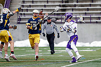 University at Albany Men's Lacrosse defeats Drexel 18-5 on Feb. 24 at Casey Stadium.  Drexel defender Will Stabbert (#18) defends Connor Fields (#5). (Photo by Bruce Dudek / Cal Sport Media/Eclipse Sportswire)