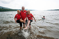 25-7-2014: Angela Collins, Dr Pat Forde and  Anne O'Sullivan cool down in the Atlantic Ocean during the 3 day Kerry Way Walk for Cancer Research at Kenmare Pier on Friday on day 1 of the three day event which will take walkers through some of the most scenic parts of South Kerry.<br /> Picture by Don MacMonagle<br /> <br /> repro free photo<br /> <br /> press release:<br /> 9th Kerry Way Cancer Research Gets Under Way <br /> Organisers hope to raise &euro;50k for cancer research projects Hundreds of walkers have descended on the Kingdom for the 9th annual Kerry Way Cancer Research walk in aid of Breakthrough Cancer Research who fund cancer research programmes administered by Cork Cancer Research Centre. <br /> <br /> The Kerry Way Cancer Research walk is a guided 70km walk over three days combining impressive mountain views, dramatic peaks and glens, wild moorlands, wooded paths and lakes along the Kerry Way trails.  Challenging but fun, the great camaraderie on the route adds to the spectacular settings and ensures a truly memorable experience in the Kingdom.  <br /> Kerry footballing legend and Breakthrough Cancer Research ambassador, Pat Spillane was on hand to wave the walkers off on their trek.  The walks over the three days include some of Irelands most fabulous walk ways Lauragh to Kenmare incorporating part of The Beara Way, Lough Inchiquin the Torc Waterfall and Esknamucky Glen, this year&rsquo;s walk features the added element of a twilight boat trip on Friday evening across the beautiful Kenmare Bay, landing at Templenoe to start the walk to Kenmare.  <br /> <br /> Speaking at the starting point Orla Dolan, Breakthrough Cancer Research Fundraising Manager said &ldquo;The Kerry Way Cancer Research Walk has gone from strength to strength raising over &euro;650,000 for cancer research in the past nine years. Today&rsquo;s walk turnout is testament to the popularity of the walk and also all the lives cancer effects, people want to play their part in the fight against cancer and we are delighted to have them here with us this weekend. We couldn&rsquo;t
