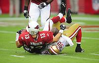 Sept. 13, 2009; Glendale, AZ, USA; Arizona Cardinals quarterback (13) Kurt Warner is sacked by San Francisco 49ers linebacker (98) Parys Haralson in the second quarter at University of Phoenix Stadium. Mandatory Credit: Mark J. Rebilas-