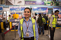 Nepal, Kathmandu. Woman that works at Buddha Air Airlines at the airport.