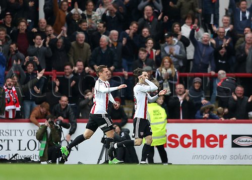 April 14th 2017,  Brent, London, England; Skybet Championship football, Brentford versus Derby County; Jota of Brentford celebrates scoring his sides 4th goal in the 90th minute to make it 4-0 with Konstantin Kerschbaumer of Brentford