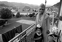 - Indian Sikh community of Arzignano (Vicenza), a woman on the balcony of its home..- comunità indiani Sikh di Arzignano (Vicenza), una donna sul balcone della sua casa