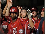 19 May 2012: Washington Nationals outfielder Bryce Harper gives a high-five in the dugout during a game against the Baltimore Orioles at Nationals Park in Washington, DC. The Orioles defeated the Nationals 6-5 in the second game of their 3-game series. Mandatory Credit: Ed Wolfstein Photo