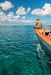 Cruising off the coast in a traditional boat on the island of Kiritimati in Kiribati