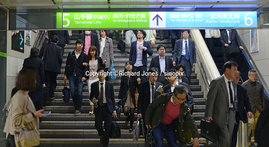 Passengers at Tokyo Station.  Tokyo station is one of big terminal stations in Tokyo.  Various Shinkansen bullet trains depart from Tokyo station.