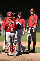 Arizona Diamondbacks catcher Michael Perez  (7), coach Robby Hammock (7) and first baseman Kevin Cron (50) during an Instructional League game against the Oakland Athletics on October 10, 2014 at Chase Field in Phoenix, Arizona.  (Mike Janes/Four Seam Images)