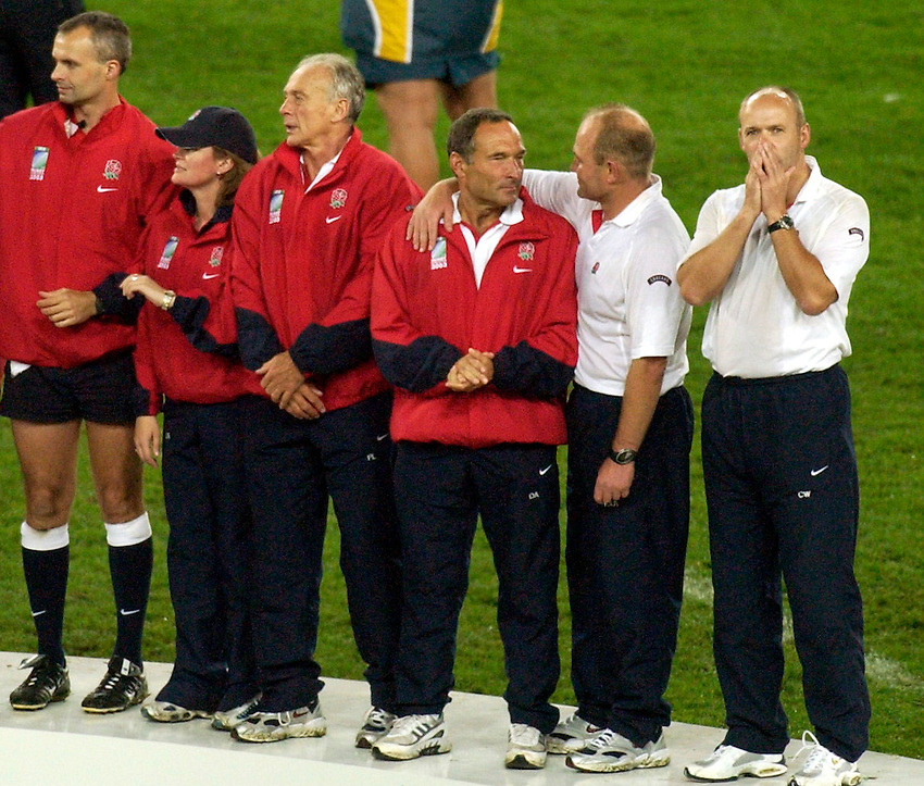Photo: Steve Holland..Australia v England. Rugby World Cup Final, at the Telstra Stadium, Sydney. RWC 2003. 22/11/2003. .The England management await their winners medals with Clive Woodward looking in disbelief.