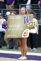 17 September 2016:  Washington cheerleader Becca Love entertained fans at the University of Washington in Seattle, WA.