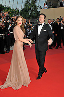 ANGELINA JOLIE &amp; BRAD PITT<br /> The &quot;Inglourious Basterds&quot; Premiere at the Grand Theatre Lumiere during the 62nd Annual Cannes Film Festival, Cannes, France.<br /> May 20th, 2009<br /> full length black tuxedo suit cream beige brown pink dress sheer long couple  back behind rear looking over shoulder hand holding <br /> CAP/PL<br /> &copy;Phil Loftus/Capital Pictures /MediaPunch ***NORTH AND SOUTH AMERICAS ONLY***