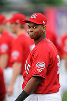 Third baseman Rafael Devers (13) of the Greenville Drive is pictured before a game against the Augusta GreenJackets on Thursday, June 11, 2015, at Fluor Field at the West End in Greenville, South Carolina. Devers is the No. 6 prospect of the Boston Red Sox, according to Baseball America. Greenville won, 10-1. (Tom Priddy/Four Seam Images)