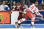 Paul Carey (BC - 22), Sean Escobedo (BU - 21) - The visiting Boston College Eagles defeated the Boston University Terriers 3-2 to sweep their Hockey East series on Friday, January 21, 2011, at Agganis Arena in Boston, Massachusetts.