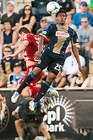 Sheanon Williams (25) of the Philadelphia Union goes up for a header with Kenny Cooper (33) of FC Dallas. The Philadelphia Union and FC Dallas played to a 2-2 tie during a Major League Soccer (MLS) match at PPL Park in Chester, PA, on June 29, 2013.