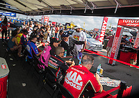 Oct 15, 2016; Ennis, TX, USA; NHRA drivers sign autographs at the Toyota Pit Pass display during qualifying for the Fall Nationals at Texas Motorplex. Mandatory Credit: Mark J. Rebilas-USA TODAY Sports
