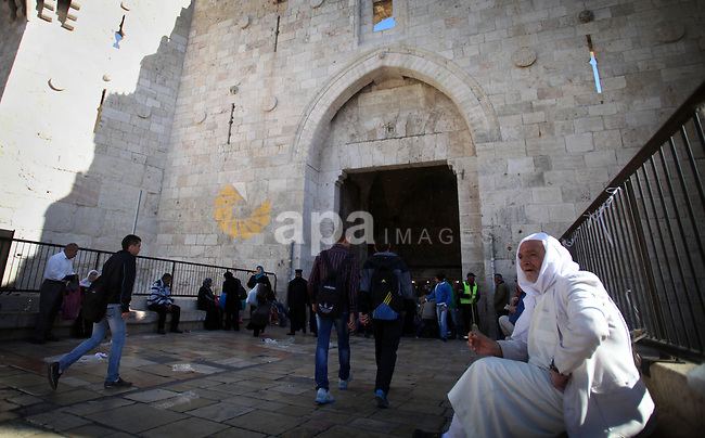 Palestinian walk in front of Damascus gater in Jerusalem's Old City on February 12, 2014. Minister of Holy Places for the PA Mahmoud al-Habbash told Israel's Channel 10 network that the PA wants control of all the areas in Jerusalem that were won by Israel during the 1967 Six-Day War, including the Western Wall. Photo by Saeed Qaq