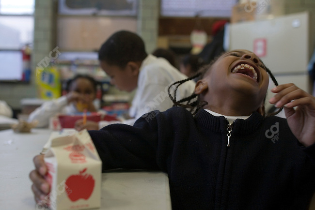©2007  David Burnett/ Contact Press Images.photographer: David Burnett.1/23/07..Philadelphia, PA.Photographs for Robert Wood Johnson Foundation:..North  Liberties Rec. Center , a neighborhood rec. center where kids after school meet to play and do school work and other projects. Today there was a lesson about Sodium and Fat in snack foods.