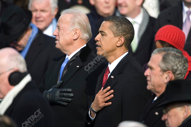 President Barack Obama and Vice-President Joe Biden salute for the National Anthem at the conclusion of their swearing-in ceremony at The Capitol Building. Washington, DC, January 20, 2009.