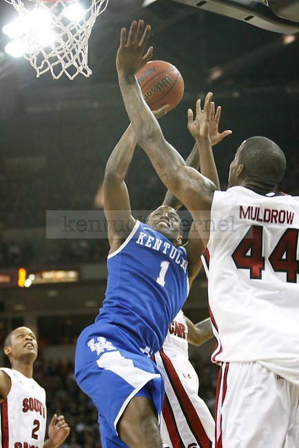 UK guard Darius Miller shoots a contested shot against South Carolina at Colonial Life Arena on Saturday, Jan. 22, 2011. Photo by Scott Hannigan | Staff