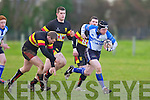 Tralee's Liam Quaid gets away from the Old Christians defence at O'Dowd park, Tralee on Saturday.