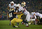 Oct. 13, 2012; Notre Dame safety Matthias Farley brings down Stanford running back Stepfan Taylor in overtime at Notre Dame Stadium. Notre Dame won 20 to 13 in overtime. Photo by Barbara Johnston/University of Notre Dame