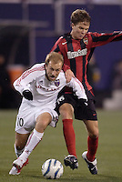 Real Salt Lake's Clint Mathis battles Michael Bradley of the MetroStars' for the ball. The weather was the story with 50 mph winds, rain, and a brief power outage as the MetroStars played Real Salt Lake to a scoreless tie during opening day action of season 10 of the MLS at Giant's Stadium, East Rutherford, on Saturday April 2, 2005.