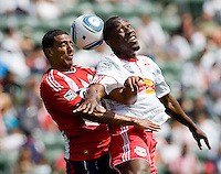 Chivas USA defender Michael Umana (4) battles with NY RedBulls defender Dane Richards (19). Chivas USA defeated the Red Bulls of New York 2-0 at Home Depot Center stadium in Carson, California April 10, 2010.  .