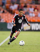 Andy Najar (14) of D.C. United carries the ball upfield during the game at RFK Stadium in Washington, DC.  D.C. United defeated Chivas USA, 1-0.