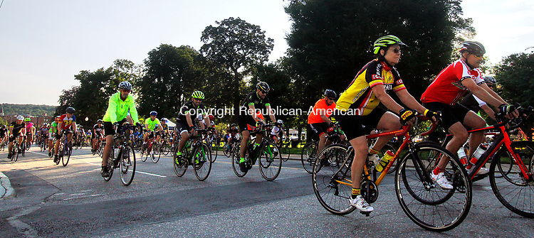 TORRINGTON, CT - 06 AUGUST 2017 - 080617JW04.jpg -- Cyclists taking part in the 75 and 55 mile rides fill Litchfield Street at the start during the 14th Annual Tour of Litchfield Hills bike ride Sunday morning at Coe Memorial Park. Funds raised from the over one thousand estimated riders was to be donated to the Cancer Care Fund of the Litchfield Hills, Inc. Jonathan Wilcox Republican-American