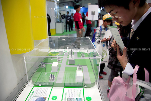 """December 13, 2012, Tokyo, Japan - A visitor sees the mini solar panels at Eco-Products Exhibition. The Eco-Products Exhibition is one of the biggest environmental issues in Japan, drawing more than 180,000 business people and consumer exhibitors. The theme of this year is """"The Greener, The Smaller - The Future We Will Choose"""", the exhibition will be held from December 13th to 15th in Tokyo Big Sight.(Photo by Rodrigo Reyes Marin/AFLO).."""