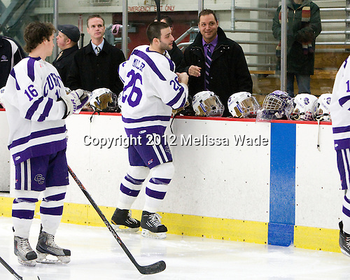 Brendan Flynn (Curry - Assistant Coach), Jonathan Miller (Curry - 26), Mike Tortorella (Curry - Assistant Coach) - The Curry College Colonels defeated the Johnson & Wales University Wildcats 5-4 on Curry's senior night on Saturday, February 18, 2012, at Max Ulin Rink in Milton, Massachusetts.