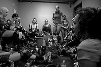 Members of the San Francisco ShEvil Dead roller derby team discuss their second half strategy in the locker room during half-time at the Bay Area Derby Girls season opener in Oakland, CA..(©Matt McKnight, 2008)