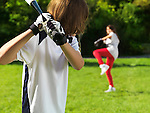 Two children, boy and girl practicing baseball. Active summer lifesttyle.