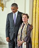 United States President Barack Obama presents the National Humanities Medal to Alice Waters of Berkeley, California, chef, author, and advocate during a ceremony in the East Room of the White House in Washington, DC on Thursday, September 10, 2015.<br /> Credit: Ron Sachs / CNP<br /> (RESTRICTION: NO New York or New Jersey Newspapers or newspapers within a 75 mile radius of New York City)
