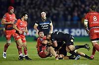 Facundo Isa of RC Toulon is tackled to ground by Tom Dunn of Bath Rugby. European Rugby Champions Cup match, between Bath Rugby and RC Toulon on December 16, 2017 at the Recreation Ground in Bath, England. Photo by: Patrick Khachfe / Onside Images