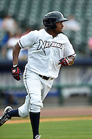 NW Arkansas Naturals outfielder Jorge Bonifacio (24) runs to first during a game against the Corpus Christi Hooks on May 26, 2014 at Arvest Ballpark in Springdale, Arkansas.  NW Arkansas defeated Corpus Christi 5-3.  (Mike Janes/Four Seam Images)