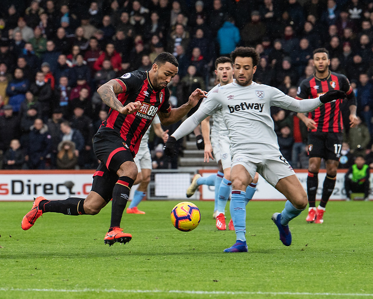 Bournemouth's Callum Wilson (left) under pressure from  West Ham United's Felipe Anderson (right)  <br /> <br /> Photographer David Horton/CameraSport<br /> <br /> The Premier League - Bournemouth v West Ham United - Saturday 19 January 2019 - Vitality Stadium - Bournemouth<br /> <br /> World Copyright &copy; 2019 CameraSport. All rights reserved. 43 Linden Ave. Countesthorpe. Leicester. England. LE8 5PG - Tel: +44 (0) 116 277 4147 - admin@camerasport.com - www.camerasport.com