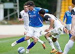St Johnstone v Inverness Caley Thistle....07.04.12   SPL.Fran Sandaza twists his way through Kenny Gillet and Graeme Shinnie.Picture by Graeme Hart..Copyright Perthshire Picture Agency.Tel: 01738 623350  Mobile: 07990 594431