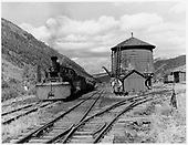 Telluride water tank and RGS K-27 #453 with a freight in the yards.<br /> RGS  Telluride, CO  ca. 1945-1951