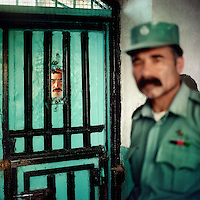 Prisoner and guard in Herat jail.