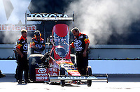 Sep 14, 2013; Charlotte, NC, USA; Crew members with NHRA top fuel dragster driver Antron Brown during qualifying for the Carolina Nationals at zMax Dragway. Mandatory Credit: Mark J. Rebilas-