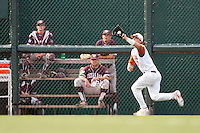 Texas Longhorns outfielder Jonathan Walsh #33 makes a catch during the NCAA baseball game against the Texas A&M Aggies on April 28, 2012 at UFCU Disch-Falk Field in Austin, Texas. The Aggies beat the Longhorns 12-4. (Andrew Woolley / Four Seam Images)..