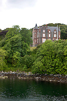 A castle in typical Scottish Baronial style situated on an inlet of the sea