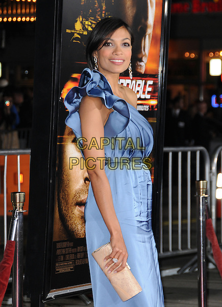 "ROSARIO DAWSON.attends the Twentieth Century Fox's L.A. Premiere of ""Unstoppable"" held at Regency Village Theater in Westwood, California, USA, October 26th 2010..half length dress blue one shoulder silk satin beige nude  clutch bag side .CAP/RKE/DVS.©DVS/RockinExposures/Capital Pictures."