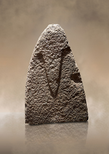 Top section of a Late European Neolithic prehistoric Menhir standing stone with carvings on its face side. The representation of a stylalised male figure starts at the top with a long nose from which 2 eyebrows arch around the top of the stone. Excavated from Amassed VII, Allai. Menhir Museum, Museo della Statuaria Prehistorica in Sardegna, Museum of Prehoistoric Sardinian Statues, Palazzo Aymerich, Laconi, Sardinia, Italy