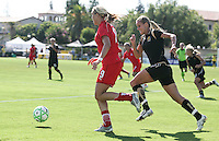 Leslie Osborne (right) chases down Allie Long (9). FC Gold Pride defeated Washington Freedom 3-2 at Buck Shaw Stadium in Santa Clara, California on August 1, 2009.