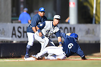 Columbia Fireflies third baseman Mark Vientos (13) fields the ball as Terrin Vavra (6) slides in safely during a game against the Asheville Tourists at McCormick Field on June 22, 2019 in Asheville, North Carolina. The Tourists defeated the Fireflies 6-5. (Tony Farlow/Four Seam Images)