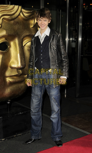 THOMAS SANGSTER .The British Academy Children's Film and Television Awards, London, Hilton Hotel, Park Lane, London, England..November 30th, 2008.BAFTA BAFTA's full length jeans denim leather jacket black brown waistcoat white belt .CAP/CAN.©Can Nguyen/Capital Pictures.
