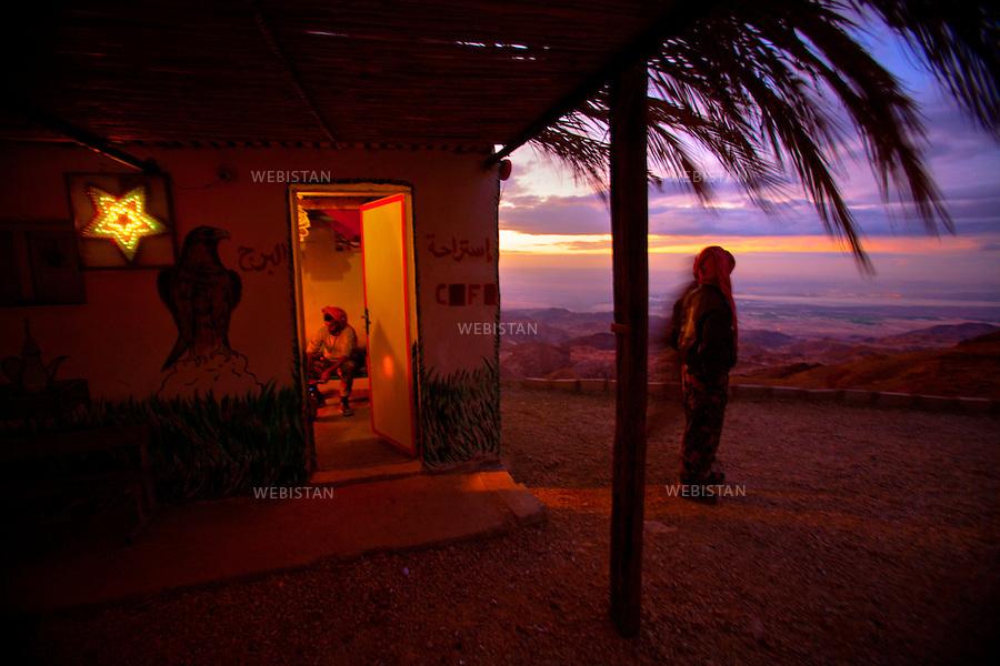 JORDAN, ON THE ROAD BETWEEN TAFILAH AND FEIFA, January 4th, 2008<br /> On the top of the mountains between Al-Karak and Tafilah. <br /> In a coffee bar, three park rangers coming from the Ruwayn village, near Talifah.<br /> <br />JORDANIE, SUR LA ROUTE ENTRE AL-KARAK ET TAFILAH, 4 janvier 2008<br /> Sur les hauteurs des montagnes entre AL-KARAK et Tafilah, une petite &eacute;choppe abritant un caf&eacute;. <br /> A l&rsquo;int&eacute;rieur, trois gardes forestiers, originiaires du village de Ruwayn, pr&egrave;s de Talifah.