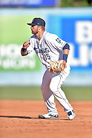 Asheville Tourists first baseman Brian Mundell (15) reacts to the play during game one of a double header against the Kannapolis Intimidators at McCormick Field on May 21, 2016 in Asheville, North Carolina. The Tourists defeated the Intimidators in game one 3-2. (Tony Farlow/Four Seam Images)