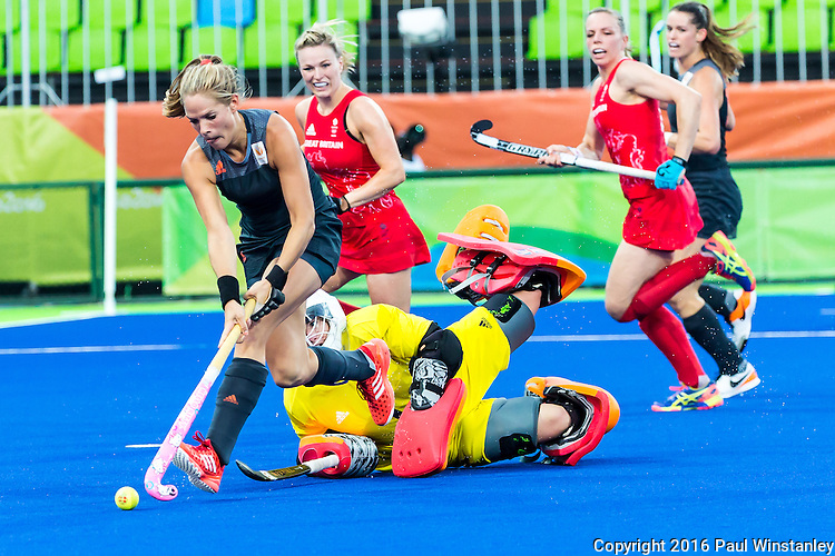 Breakaway by Kitty van Male #4 of Netherlands as Maddie Hinch #1 of Great Britain attempts to save during Netherlands vs Great Britain in the gold medal final at the Rio 2016 Olympics at the Olympic Hockey Centre in Rio de Janeiro, Brazil.