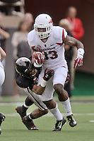 STAFF PHOTO BEN GOFF  @NWABenGoff -- 09/13/14 Arkansas running back Korliss Marshall attempts to break the tackle of Texas Tech defender Justis Nelson in the first quarter of the game in Jones AT&T Stadium in Lubbock, Texas on Saturday September 13, 2014.